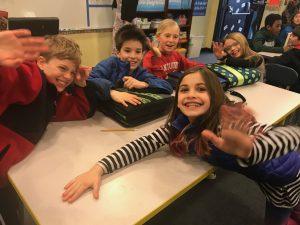 waving 4th graders